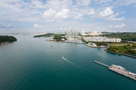 singapore: View of the strait separating the island of Sentosa and Singapore with birds-eye view.