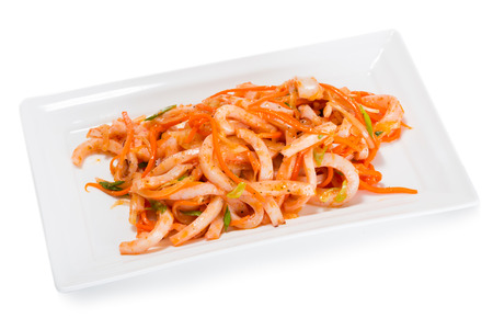 korean salad: Salad of boiled squid and carrots and spices. From a series of Food Korean cuisine. Stock Photo