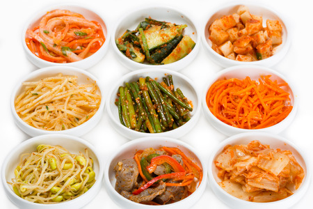ventricles: Spicy salads of traditional Korean cuisine: soy sprouts, bamboo shoots, chicken ventricles, chimchi, raw potatoes, carrots, boiled squid, cucumbers and zucchini. Stock Photo