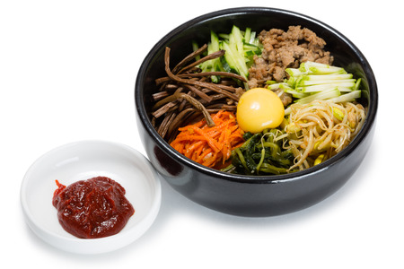 Bibimbap dish of meat, rice, vegetables and egg. From a series of Food Korean cuisine. Фото со стока
