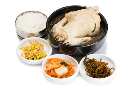 ginseng roots: Chicken boiled with ginseng roots, rice and spicy salads. From a series of Food Korean cuisine.