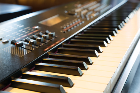 keyboard key: Electronic musical keyboard synthesizer close-up