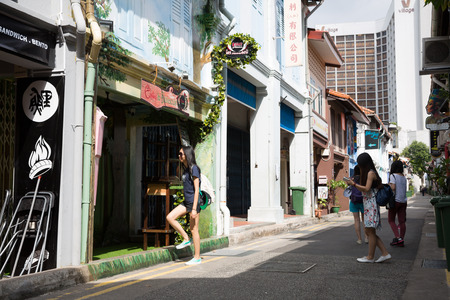 arab glamour: SINGAPORE - CIRCA FEBRUARY, 2015: Tourists in the streets of the Arab quarter (Kampong Glam). Arab Quarter is the oldest historic shopping district of Singapore, is popular for visiting tourists.