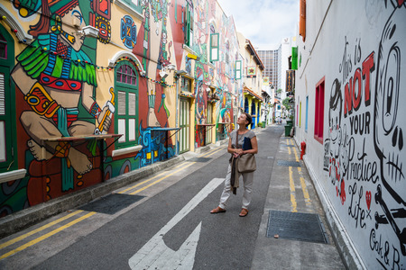 singapore: SINGAPORE - CIRCA FEBRUARY, 2015: Graffiti on the walls of old buildings Haji Lane. Haji Lane is the Kampong Glam neighbourhood famous for its cafes, restaurants and shops.