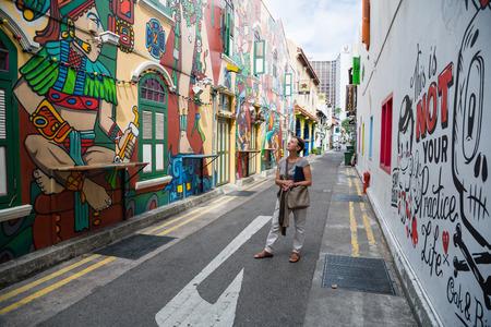 SINGAPORE - CIRCA FEBRUARY, 2015: Graffiti on the walls of old buildings Haji Lane. Haji Lane is the Kampong Glam neighbourhood famous for its cafes, restaurants and shops. Sajtókép