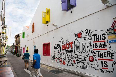 neighbourhood: SINGAPORE - CIRCA FEBRUARY, 2015: Graffiti on the walls of old buildings Haji Lane. Haji Lane is the Kampong Glam neighbourhood famous for its cafes, restaurants and shops.