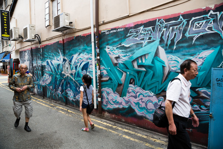 arab glamour: SINGAPORE - CIRCA FEBRUARY, 2015: Graffiti on the walls of old buildings Haji Lane. Haji Lane is the Kampong Glam (Arab Quarter) quarter famous for its cafes, restaurants and shops. Editorial