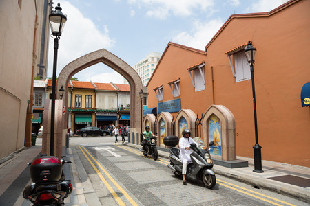 arab glamour: SINGAPORE - CIRCA FEBRUARY, 2015: People in the Arab quarter (Kampong Glam). The Arab Quarter is the oldest historic shopping district of Singapore, is very popular for visits by foreign tourists.