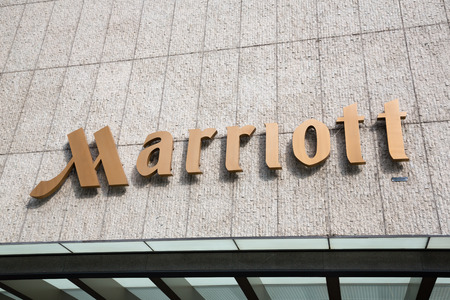 diversified: SINGAPORE - CIRCA FEBRUARY, 2015: Sign Marriott on the hotel. Marriott International, Inc. is an American diversified hospitality company that manages and franchises a broad portfolio of hotels.