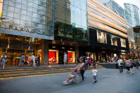 paragon: SINGAPORE - CIRCA FEBRUARY, 2015: People walk the Orchard Road - is a 2.2 kilometre long boulevard that is the retail and entertainment hub of Singapore. It is a huge tourist attraction, evening. Editorial