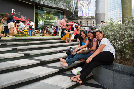 ion: SINGAPORE - CIRCA FEBRUARY, 2015: People relax in the entertainment area at the mall ION Orchard - one the best shopping centers on Orchard Road. In the mall more than 300 shops of the famous brands. Editorial