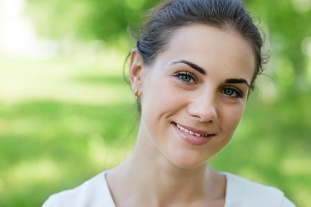 headshot: Beautiful smiling girl in the park Stock Photo