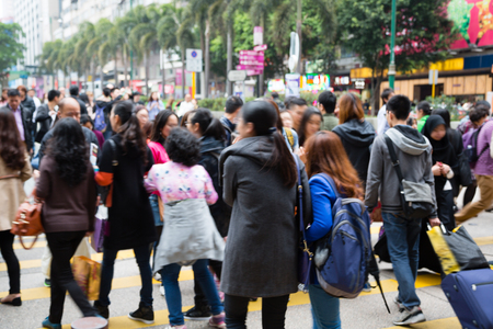 anonymous people: Crowd of anonymous people walking on busy Hong Kong street. Picture is not in focus.
