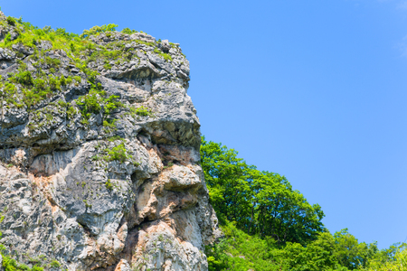 allocated: Natural rock in the shape of a human head allocated to the mountain range. Far East, Russia.