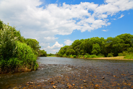 far east: River summer landscape with blue sky and clouds. Far East, Russia.