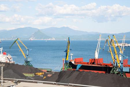 berth: Berths with coal at the port of Nakhodka, Russia. Stock Photo