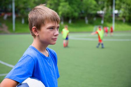 sports club: Children playing football at the stadium