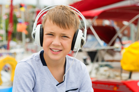 Boy listening to music with headphones stylish photo