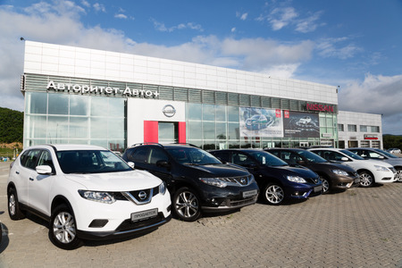 automaker: ARTYOM, RUSSIA - CIRCA AUGUST, 2015: Cars at the dealership of Nissan for the city of Vladivostok. Nissan Motor Co., Ltd. - Japanese automaker, one of the largest in the world and the third in Japan.