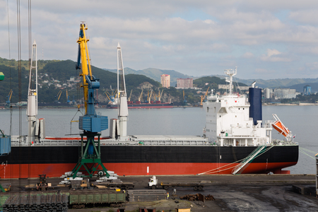 unloading: Unloading and loading of rolled metal at the port of Nakhodka, Russia.