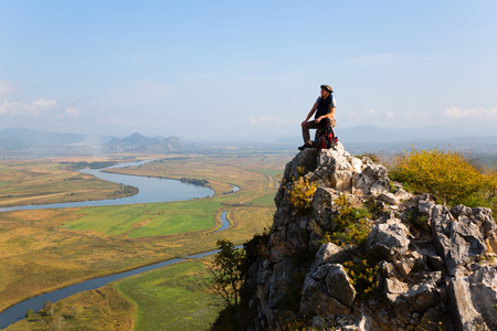 climbed: Hiker climbed a mountain and admire nature. Autumn morning.
