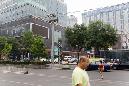 specializes: BEIJING - CIRCA JUNE, 2015: Shopping centers and stores on the street Yabaolu in Beijing. Yabaolu and surrounding neighborhoods - shopping district, which specializes in the wholesale trade with Russia