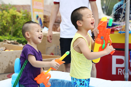 out of water: BEIJING - CIRCA JUNE, 2015: People queued to visit the attraction in the Happy Valley Beijing, lot of people visit park on weekends and weekdays. Children shoot out water from toy guns. Editorial