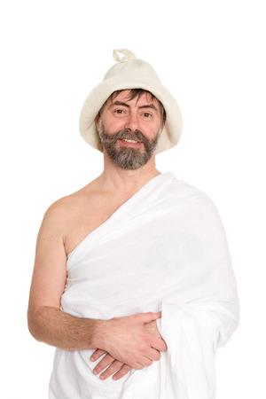 sauna nackt: L�chelnd Mann mittleren Alters in der traditionellen Bad gekleidet. Aus einer Serie von russischen Bad.