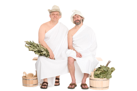 sauna nackt: Two middle-aged men in traditional Russian sauna bathing costumes. From a series of Russian bath