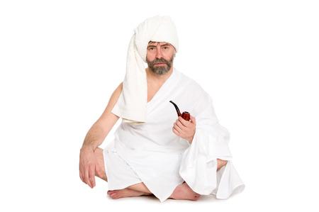 sauna nackt: Mann mit einem Rohr in der Sauna Kleid. Aus einer Serie von russischen Bad.