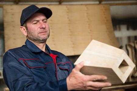 furniture part: Inspector carpenter inspecting wood furniture part in the carpentry workshop