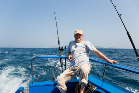 blue marlin: Fisherman fishes tuna trolling in the Andaman Sea, Thailand