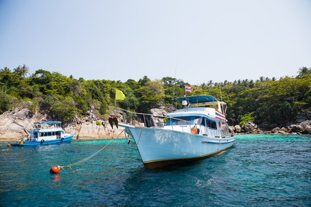 phuket food: Cruise boats with tourists off the island in the Andaman Sea, coast Thailand