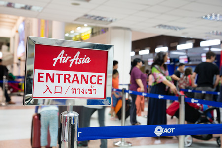tourism industry: PHUKET ISLAND, THAILAND - CIRCA FEBRUARY, 2015: People stand on the registration of the company Air Asia in Phuket International Airport. Airport plays an important role in tourism industry Thailand
