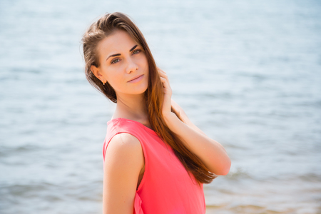 aucasian: Portrait of a beautiful girl on a background of the tropical sea Stock Photo