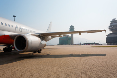 lap: Passenger aircraft parked at the international airport of Hong Kong Chek Lap Kok. Stock Photo