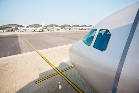 chek: Passenger plane parked at the international airport of Hong Kong Chek Lap Kok