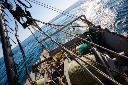 trawl: Fishing boat fishing by trawl in coastal waters. Sea of Japan.