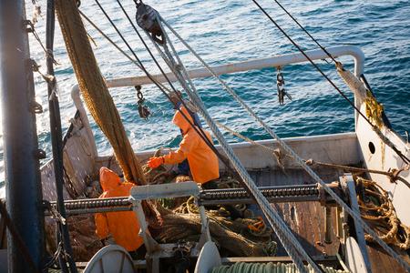 trawl: Fishermen pull trawl fish. Sea of Japan. Stock Photo