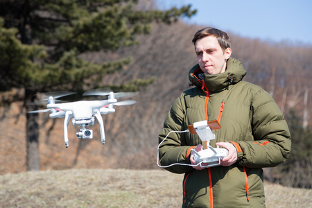 flying man: Man controls the flying drones spring