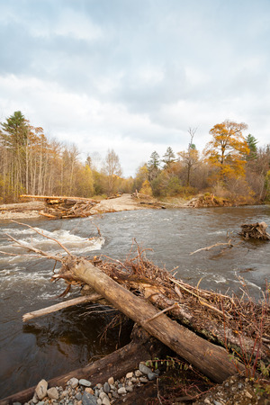 roadless: Destroyed road wooden bridge in the distant taiga area. Autumn, Far East Russia. Stock Photo