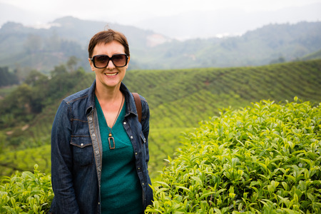 cameron highlands: Smiling woman is on the tea plantations in the mountainous district of Cameron Highlands, Malaysia.