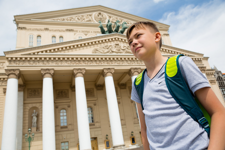quadriga: Boy stands in the background of the Bolshoi Theatre, Moscow Stock Photo