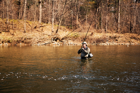 salmon falls: Fisherman catches of grayling in the mountain river Stock Photo