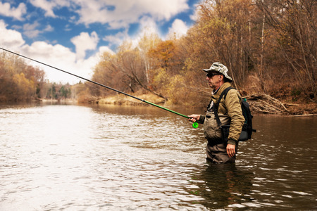 Grayling fishing on the river in the autumn Stock Photo