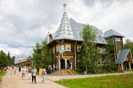 VERHNIE MANDROGI, RUSSIA - CIRCA JUNE, 2016: People on the streets of the russian tourist center Verhnie Mandrogi. Center serves tourists and cruise the passenger ships by the river Svir.