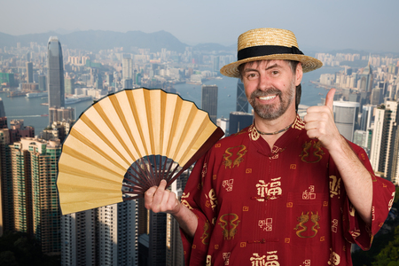 European man in traditional Chinese costume at the Victoria peak in Hong Kong photo