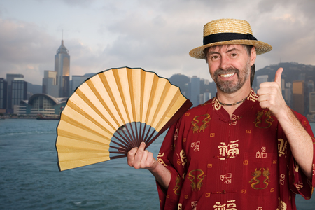 European man in a traditional Chinese costume against the background of Hong Kong photo