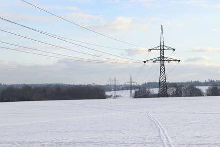 High voltage power lines in a winter landscape. Standard-Bild
