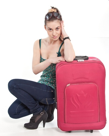 Young woman, resting on her bags